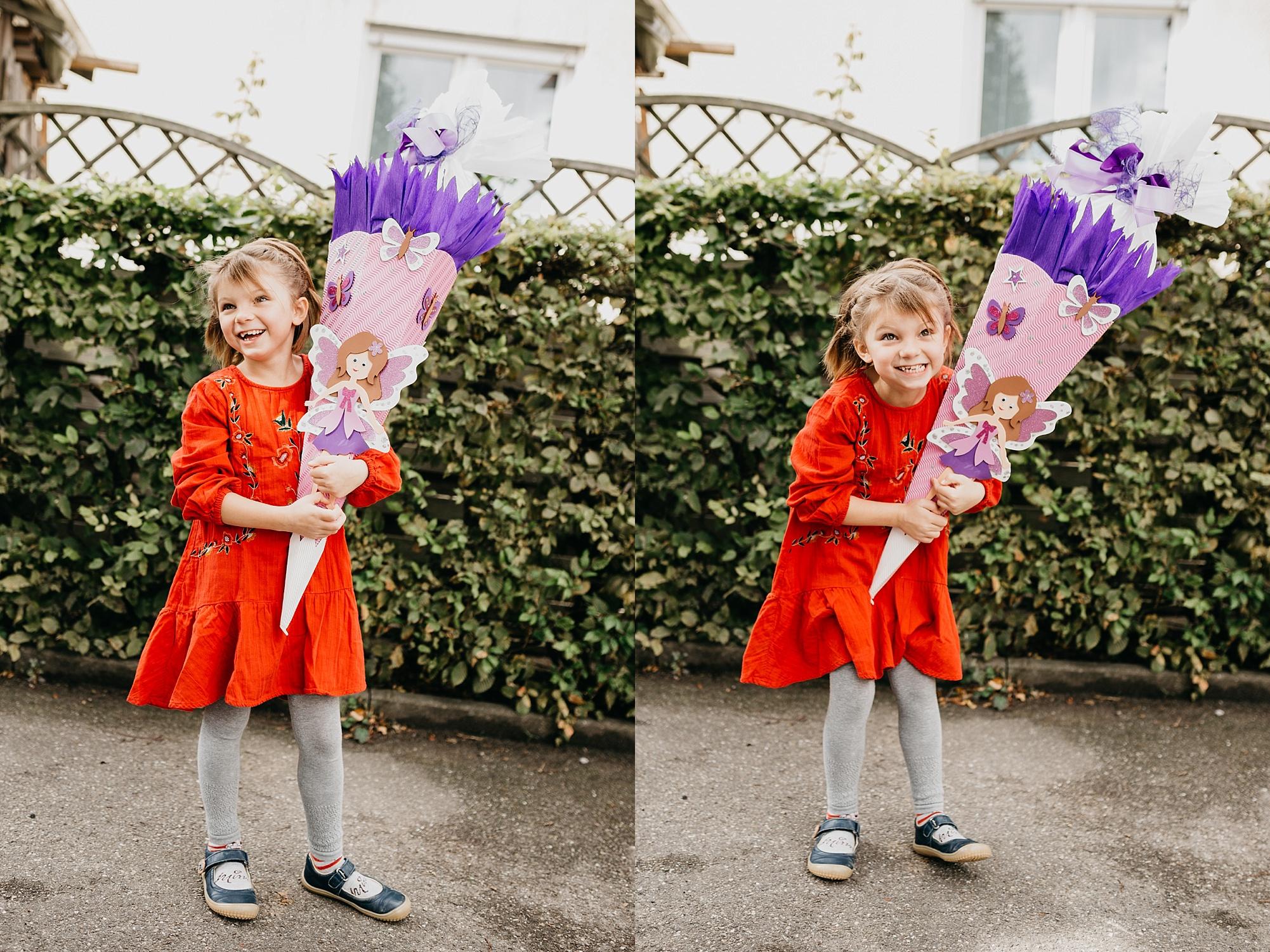 Einschulung Portrait eines Mädchens mit Schultüte